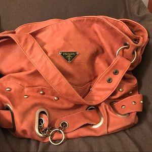 Orange satchel, brass hardware